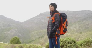 Happy smiling woman enjoying a misty hike stock footage