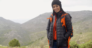 Happy smiling woman enjoying a misty hike Stock Photography