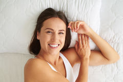 Happy smiling woman is full of positive emotions Stock Image