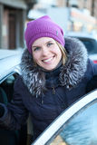 Happy smiling woman get in car Stock Image