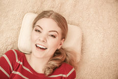Happy smiling woman girl relaxing in bed. Royalty Free Stock Photo