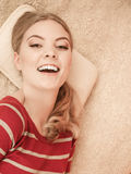 Happy smiling woman girl relaxing in bed. Stock Photography