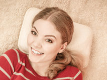 Happy smiling woman girl relaxing in bed. Stock Photos