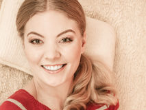 Happy smiling woman girl relaxing in bed. Stock Photo
