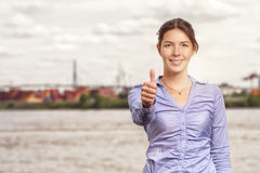 Happy smiling woman giving a thumbs up Royalty Free Stock Image