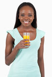 Happy smiling woman with a glass of orange juice Royalty Free Stock Images