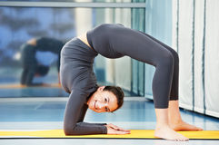 Happy smiling woman at gymnastic fitness exercise Royalty Free Stock Photos
