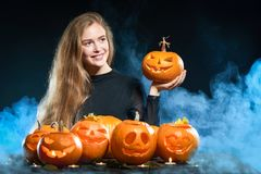 Woman with Halloween pumpkins Stock Images