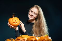 Woman with Halloween pumpkins Royalty Free Stock Photo