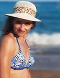 Happy smiling woman in hat on blue sea background Royalty Free Stock Images