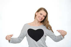 Happy smiling woman with heart symbol. Young happy smiling woman with heart symbol Stock Photos