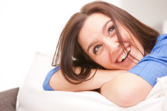 Happy smiling woman in her white living room Stock Photo