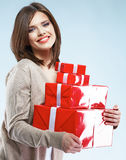 Happy smiling woman hold red gift box. Studio background female model Stock Photo