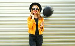 happy smiling woman holding black air balloon stock image
