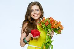 Happy smiling woman holding presents. Flowers and gift box. White background isolated Royalty Free Stock Photos