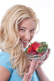 Happy smiling woman holding strawberries Stock Image