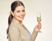 Happy smiling woman holds vine glass with vitamin pills Royalty Free Stock Photo