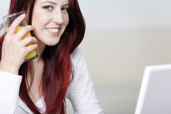Happy smiling woman at home on laptop Royalty Free Stock Photos