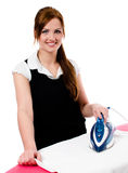 Happy smiling woman housewife ironing. Clothes -   on white background Stock Image