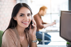 Happy smiling woman keeping telephone Royalty Free Stock Images