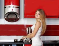 Happy smiling woman on kitchen Stock Photos