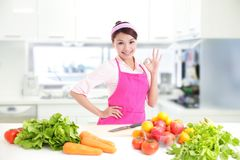 Happy smiling woman in kitchen Stock Photos