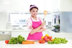Happy smiling woman in kitchen royalty free stock images