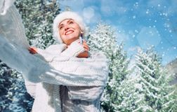 Happy smiling woman in knitwear and fur hat enjoy sunny winter d stock images