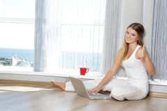 Happy smiling woman with laptop working Royalty Free Stock Images