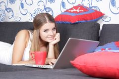 Happy smiling woman with laptop working Stock Images
