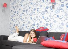 Happy smiling woman with laptop working Stock Photos