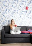 Happy smiling woman with laptop working Royalty Free Stock Image