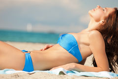 Happy smiling woman laying on a towel Royalty Free Stock Photo