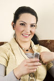 Happy smiling woman listen music Stock Photography