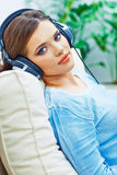 Happy smiling woman listening music with headphone Stock Photography