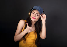 Happy smiling woman listening the music wireless earphones in bl Stock Images