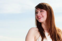 Happy smiling woman looking into space. Sun, portrait, feminity concept. Happy smiling woman looking into space somewhere in clear sky, outdoor shot royalty free stock photography