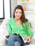 Happy and smiling woman with magazine Royalty Free Stock Photo