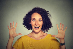 Happy, smiling woman making five times sign gesture with hands fingers Royalty Free Stock Image