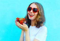 Happy smiling woman with many strawberry Royalty Free Stock Images