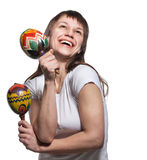 Happy smiling woman with maracas Stock Photo