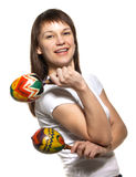 Happy smiling woman with maracas Stock Image
