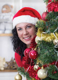 Happy smiling woman next to the Christmas tree Stock Image
