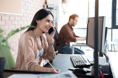 Happy smiling woman in office Royalty Free Stock Images