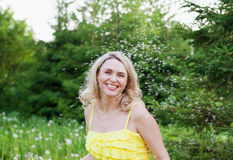 Happy smiling woman outdoors in summer Stock Images