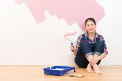 Happy smiling woman painting interior in pink Stock Photos