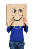 Happy smiling woman with paper bag on head Royalty Free Stock Image
