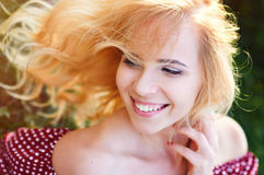Happy smiling woman in a park on the grass Stock Images