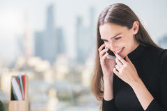 Happy smiling woman on phone Royalty Free Stock Photography
