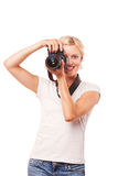 Happy smiling woman photographer shooting Royalty Free Stock Photos